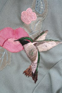 detail of hummingbird and appliqué