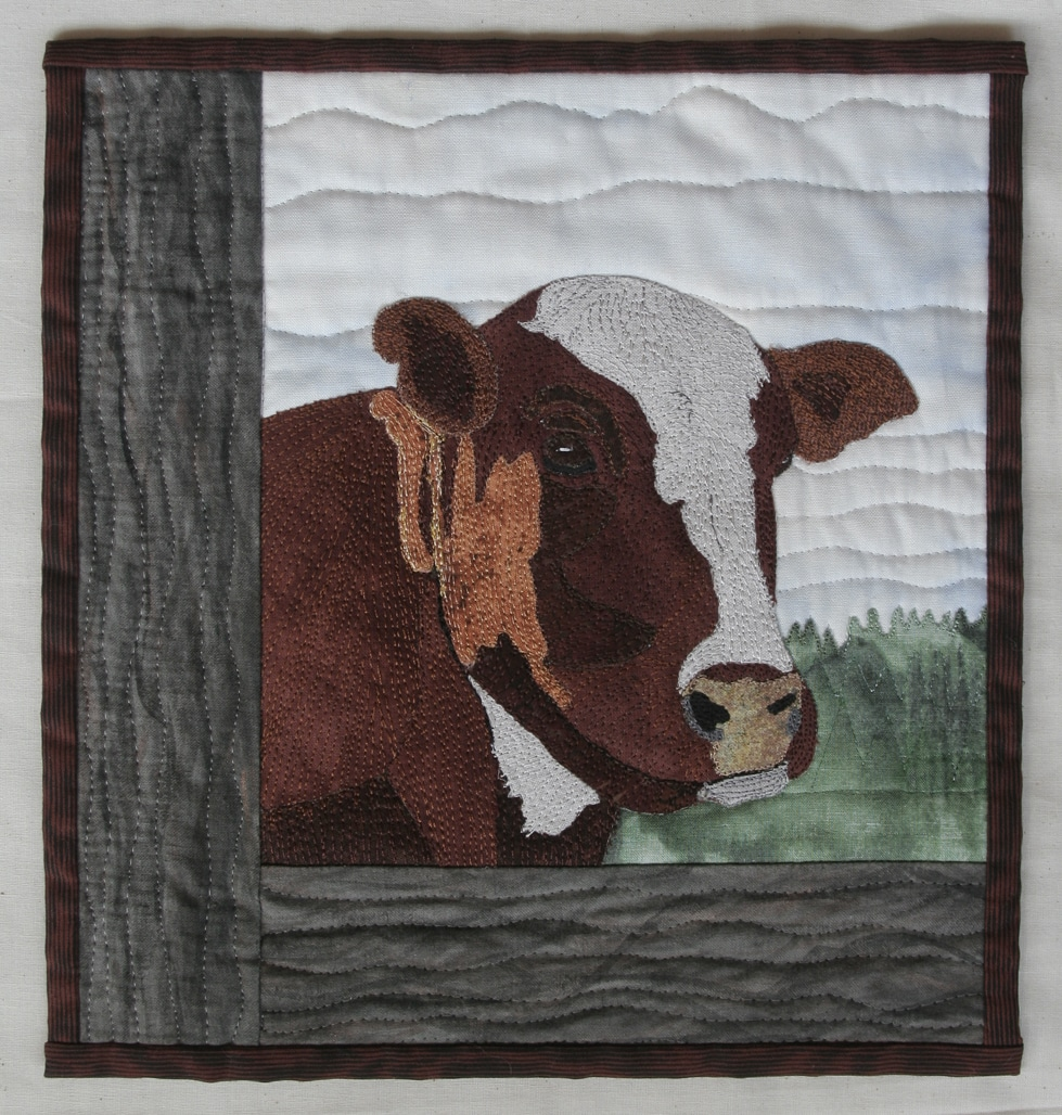 cow-thread stitched wall quilt